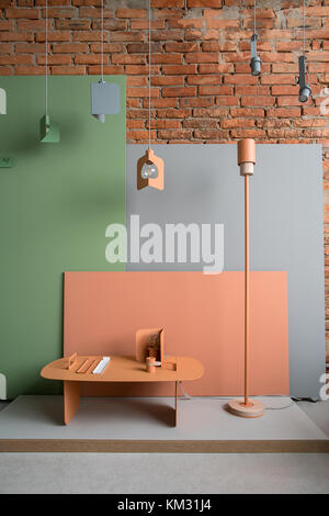 Interior in loft style with colorful furniture - Stock Photo