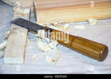 Chisel on the table among the shavings - Stock Photo