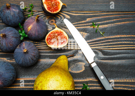 Figs on wooden background - Stock Photo
