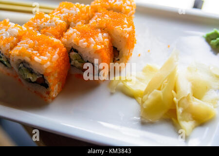 Close up tasty Japanese rolls on plate - Stock Photo