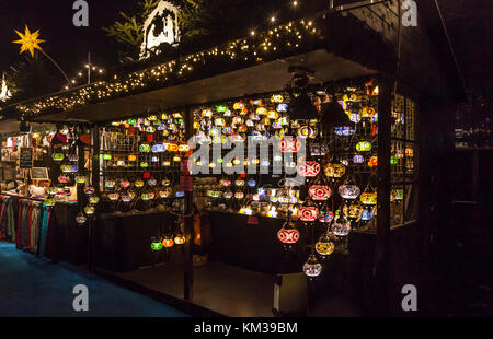 A Christmas market stall selling Moroccan style glass lampshades at Edinburgh's Christmas in Princes Street Gardens, - Stock Photo