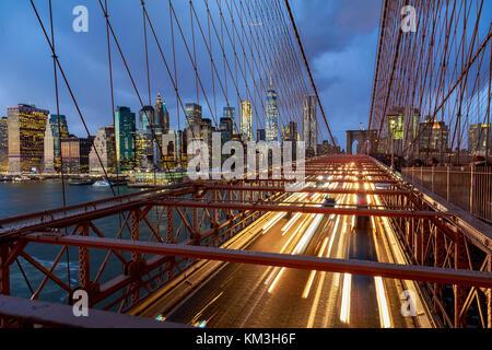 Cars driving along 'Brooklyn Bridge' suspension bridge in New York. - Stock Photo