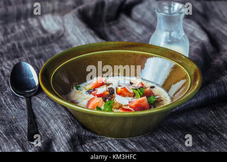 Granola. Granola with milk and berries on the table. - Stock Photo