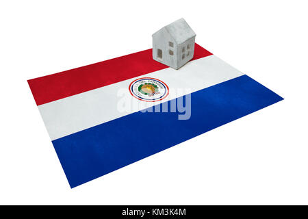 Small house on a flag - Living or migrating to Paraguay - Stock Photo