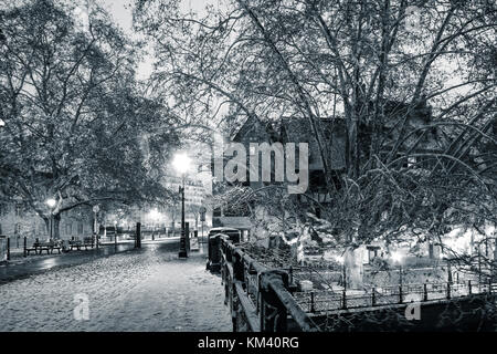 Snow-covered night street in Strasbourg black and white view, France - Stock Photo