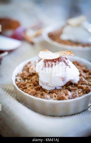 Apple Crumble Dessert With Cinnamon And Vanilla Ice Cream On Wooden Background - Stock Photo