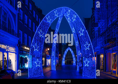LONDON, UK - DECEMBER 2nd 2017: Christmas decorations on South Molton Street, Mayfair area in London. The car-free - Stock Photo