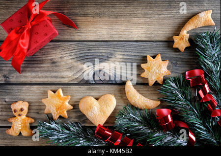 Top view of decorations for Christmas and New Year on an aged wooden table. - Stock Photo