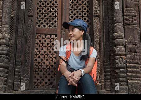 Relaxing at Pashupatinath temple in Durbar Square in Bhaktapur, Nepal - Stock Photo