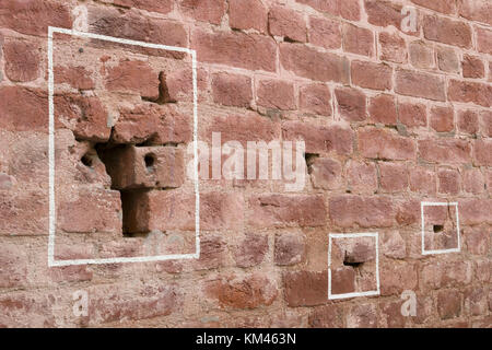 Machine gun bullet holes in brick wall at Jallianwala Bagh, Amritsar, where the British Army opened fire and massacred - Stock Photo
