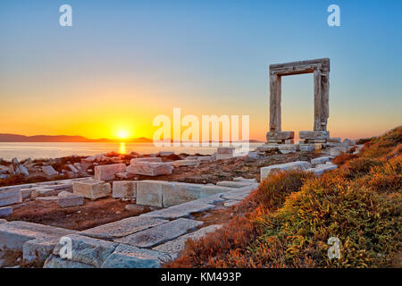 The sunset from Portara in Chora of Naxos island, Greece - Stock Photo