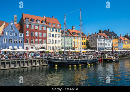 Nyhavn district is one of the most famous landmarks in Copenhagen, Denmark - Stock Photo