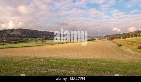 An English Landscape in the Chiltern Hills with the Village of Hambleden in the distance - Stock Photo