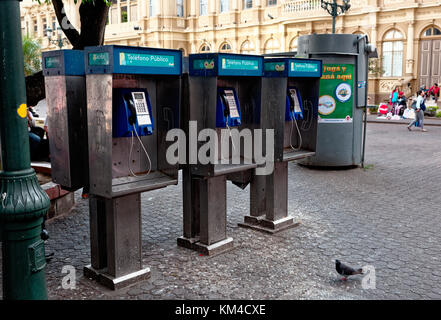 Row of public telephones outside The Grand Post Office and Telegraph building in San Jose, Costa Rica - Stock Photo