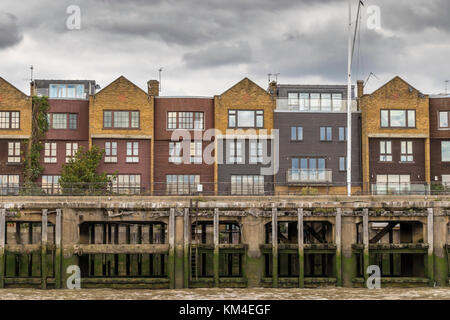 Riverside Apartments and Flats Overlooking the River Thames, Docklands ,London - Stock Photo