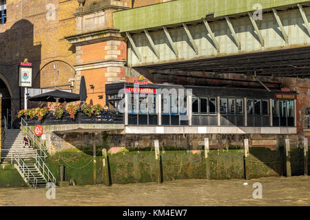 'The Banker' a London Riverside pub in The City Of London ,  located next to Cannon St Railway  Bridge - Stock Photo