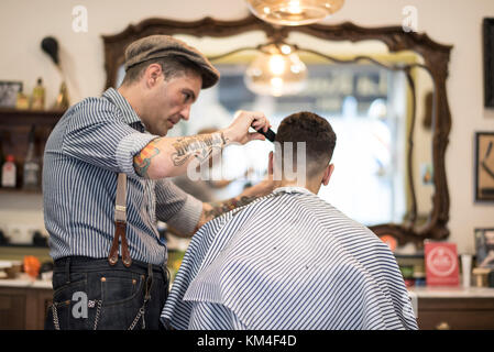 Barber shop, man cuts person hair - Stock Photo
