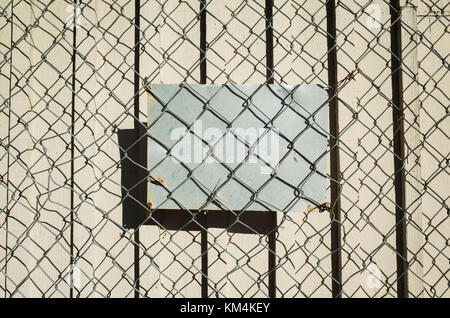 Mesh wire fence, detail, sign, \