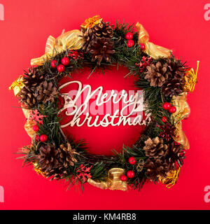 Christmas Wreath, Holiday Composition on a Red Background. Top View - Stock Photo