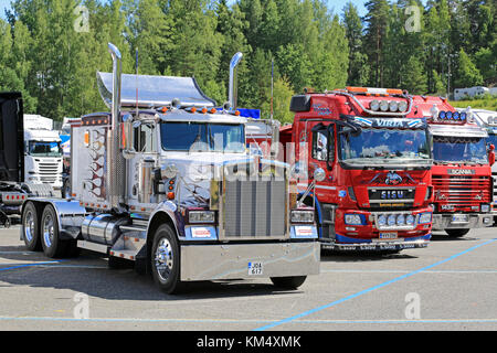 HAMEENLINNA, FINLAND - JULY 11, 2015: Classic Kenworth and Finnish cab over show trucks at Tawastia Truck Weekend - Stock Photo