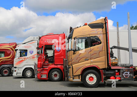 HAMEENLINNA, FINLAND - JULY 11, 2015: Lineup of colorful Volvo and Scania Trucks at Tawastia Truck Weekend 2015. - Stock Photo