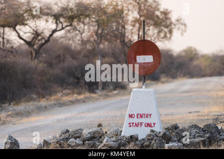 Hand painted no entry sign along road in Etosha National Park, Namibia - Stock Photo