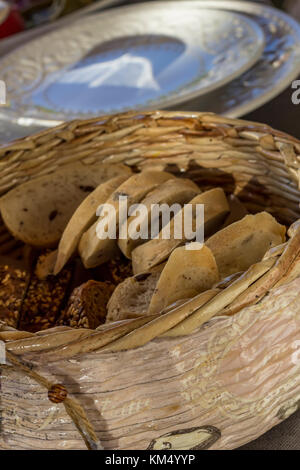 Bread in basket. Slices roll white bread and whole grain bread in the basket served on the table - Stock Photo