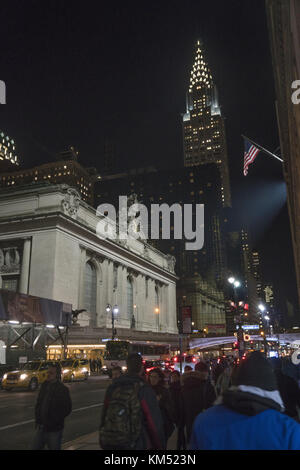 Looking East on 42nd Street passed Grand Central Terminal with the iconic Chrysler Building shooting up in the background - Stock Photo
