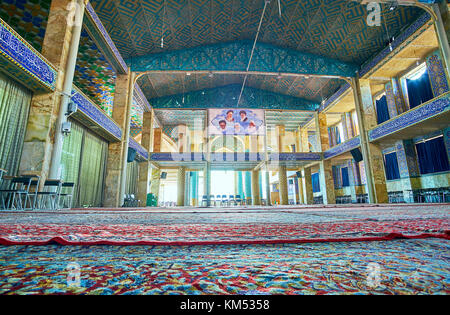 YAZD, IRAN - OCTOBER 17, 2017: Huge prayer hall with numerous windows of Hazayer Mosque, on October 17 in Yazd - Stock Photo