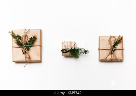 Three Vintage gift boxes with spruce branches on white isolated background, top view - Stock Photo