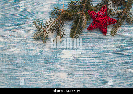 A blue wooden Christmas background with decorations - Stock Photo