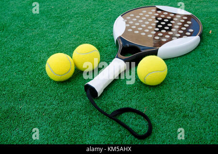 Paddle Tennis objects on Turf - Stock Photo