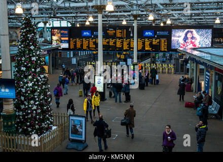 Edinburgh, Scotland, United Kingdom, 4th December 2017. Decorated Christmas tree at Waverley Station, with electronic - Stock Photo