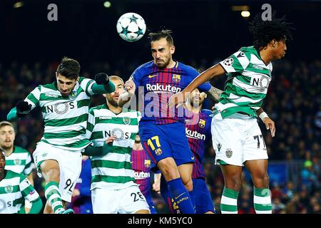 FC Barcelona's striker Paco Alcacer (C) scores the first goal against Sporting Lisboa during the UEFA Champions - Stock Photo