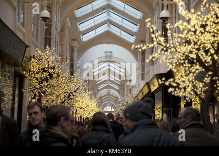 Christmas decorations and lights in Burlington Arcade in Mayfair in London, England, United Kingdom. - Stock Photo