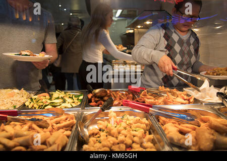 Eat as much as you like Chinese restaurant in Chinatown in London, England, United Kingdom. Many people eat bargain - Stock Photo