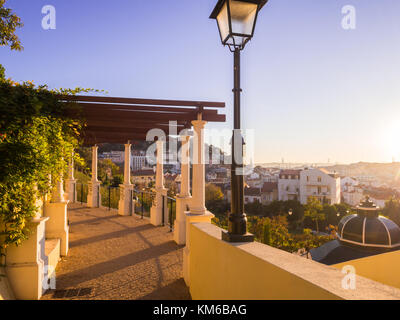 LISBON, PORTUGAL - NOVEMBER 19, 2017: Jardim da Cerca da Graca in Lisbon, Portugal, at sunset. Sao Jorge castle - Stock Photo