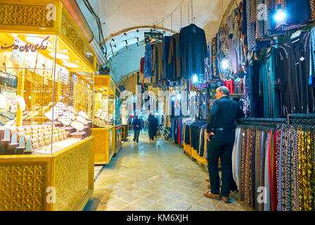 YAZD, IRAN - OCTOBER 17, 2017: Bazaar in Yazd offers variety of goods from jewelry to clothes, on October 17 in - Stock Photo