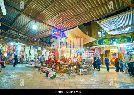 YAZD, IRAN - OCTOBER 17, 2017: Bazaar in Yazd is a popular tourist landmark and the best place to buy souvenirs - Stock Photo