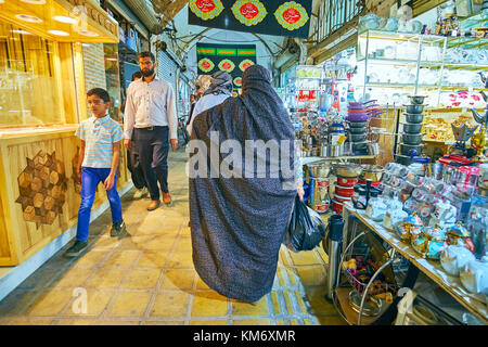 YAZD, IRAN - OCTOBER 17, 2017: Central bazaar in Yazd is the place where locals make their daily shoppings or just - Stock Photo