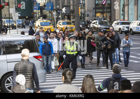 Crowds of tourists and shoppers at the corner of 42nd Street and 5th Avenue during the Black Friday Thanksgiving - Stock Photo