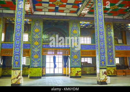 YAZD, IRAN - OCTOBER 17, 2017:  Women's part of Hazayer Mosque is derorated with tiled columns and walls, on October - Stock Photo
