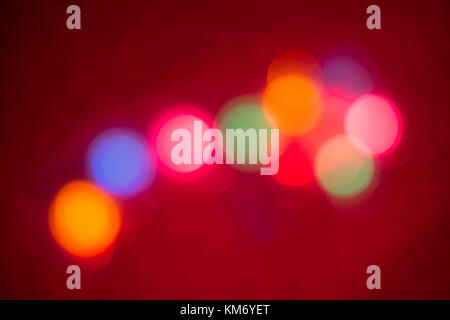 Blurry multicolored spherical lights on black, can use background - Stock Photo