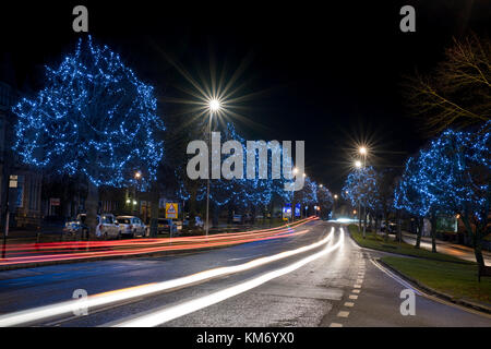 Christmas lights and car light trails in Brackley, Northamptonshire, England - Stock Photo
