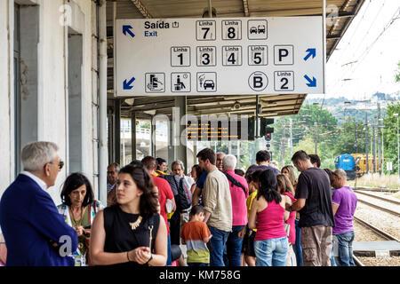 Coimbra Coimbra Portugal B Comboios de Portugal railway train station platform waiting woman man crowded sign directions - Stock Photo
