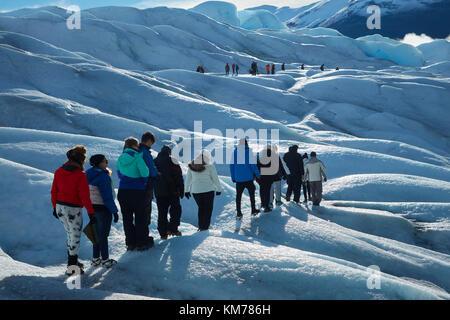 Hikers on Perito Moreno Glacier, Parque Nacional Los Glaciares (World Heritage Area), Patagonia, Argentina, South - Stock Photo