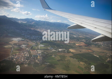 View from the airplane window. Beautiful scenery from an unexpected perspective. Terraneous objects seem to be toy. - Stock Photo