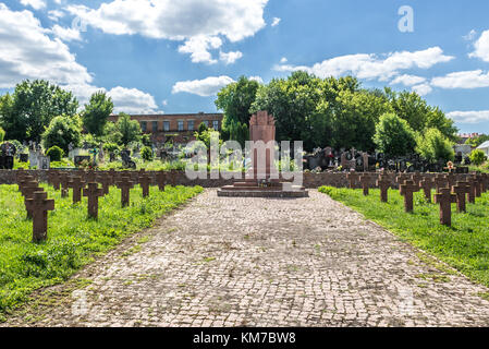 Graves of Polish soldiers killed during Polish–Soviet War on a cemetery in Chortkiv city in Ternopil Oblast of western - Stock Photo