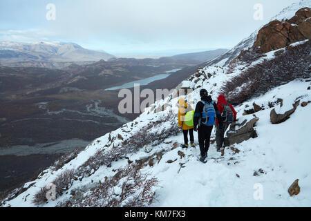 Hikers in snow on track to Laguna de los Tres, Parque Nacional Los Glaciares (World Heritage Area), Patagonia, Argentina, - Stock Photo
