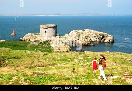 Napoleonic period Martello tower, military invasion defence fort, on island of Irelands Eye near Howth, County Dublin, - Stock Photo